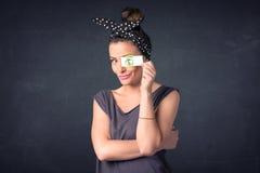 Moça que guarda de papel com sinal de dólar verde Imagem de Stock