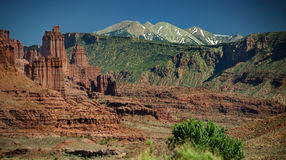 Moab Mountain Vista, Canyon Rocks and Mountains. Dramatic red sandstone cliffs foreground summer mountains in Moab, Utah Stock Photo
