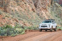 Toyota 4runner SUV on a desert trail. Moab , UT, USA - May 6, 2018:  Toyota 4runner SUV 2016 trail edition, stock vehicle without any off road modifacations on a Stock Image