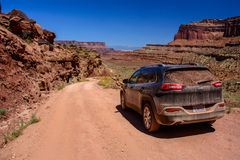 Moab, Utah, USA - June 15, 2015: Jeep Cherokee on a White Rim road Shafer Trail road in Canyonlands national park Royalty Free Stock Photo
