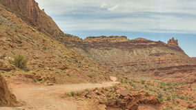 Moab winding off-road trail in the orange mountains desert Stock Images