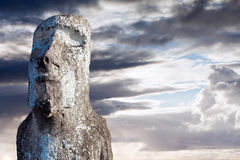 Moai covered in lichen in Easter Island. Against dramatic sky royalty free stock image