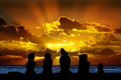 Moai in Easter Island at sunset. Silhouettes of standing moai against dramatic orange sunset stock photography