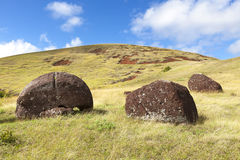Moai hats on hillside in Easter Island Stock Image