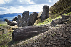 Moai heads and laying moai in Rano Raruku mountain Royalty Free Stock Image