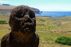 Moai at Rano Raraku Easter  Island (Rapa Nui). Moai at Rano Raraku quarry with Ahu Tongariki in the distance, Easter Island, Chile Stock Photos