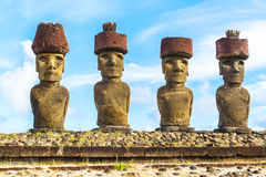 Moai with red topknot hat. At Ahu Nau Nau in Anakena Beach on Easter Island, Chile Royalty Free Stock Images