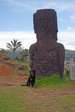 Moai statue with dog at Rapa Nui - Easter Island Royalty Free Stock Photography