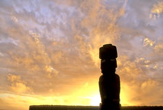 Moai statue- Easter Island. Moai statue silhouetted at dawn on Easter Island, Chile Stock Photo