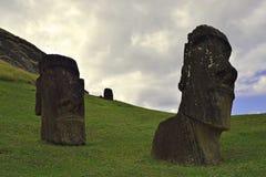 Moai statues at Rano Raraku, Easter Island. Moai at the quarry, known as Rano Raraku, Easter Island, Chile Royalty Free Stock Photo