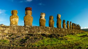 Moai statues rear view on Easter Island. Ahu Tongariki. Rear view panorama of Moai statues on Easter Island. Ahu Tongariki, Chile stock photography