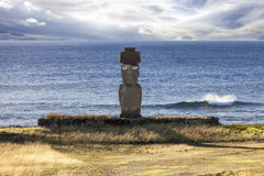 Moai with white eyes with sea in background Royalty Free Stock Images
