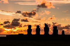 Moais backligth in an Easter Island sunset royalty free stock image