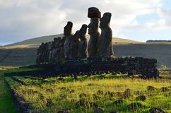 Moais in the ceremonial platform Ahu at Tongariki beach, Rapa Nui Easter island. Ahu Tongariki is the largest ahu on Easter Island. Its moai were toppled during Stock Image