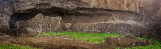 Moais quarry in Easter Island, moai during the carving. Panoramic detail of the moai during the carve Royalty Free Stock Images