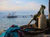 Moalboal Cebu. Anchor, Panagsama Beach Moalboal. Cebu Dive Centre. Dive boat. Sarong Stock Images