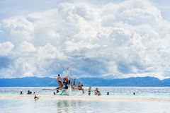 Moalboal. Cebu. Philippines. - 24 june 2016: Asian people with tourists getting fun and rest on the boat in tropical sea Stock Photo