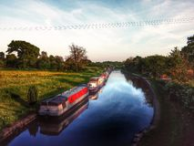 Moored canal boats. Moored narrow boats in Cheshire Uk Stock Images
