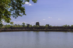 The moat around Angkorwat. The huge moat and the causeway leading to the entrance to Angkor Wat Stock Photo