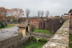 Moat and bridge to the main gate of the Medici Fortress of Santa Barbara. Pistoia. Tuscany. Italy. Royalty Free Stock Photo