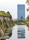 Moat filled with water from the walls of the ancient Samurai cas. OSAKA, JAPAN- OCTOBER 03, 2016: Moat filled with water from the walls of the ancient Samurai Stock Photography
