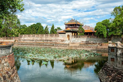 Moat of the Imperial City (Citadel) at Hue, Vietnam. Moat of the Imperial City at Hue. With lotus flowers, tree and blue sky royalty free stock photo