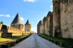 Moat of the medieval city of Carcassonne, France. View down the moat of the medieval walled city of Carcassonne, France Royalty Free Stock Images