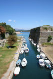 Moat Moorings. A castle moat in Corfu is used as a mooring area for boats royalty free stock images