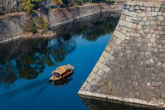 Moat Sailing. A tour boat sailing in the moat around Osaka Castle Royalty Free Stock Photos