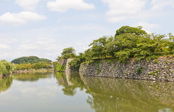 Moat and stone walls of Himeji castle, Japan. UNESCO site Stock Photos
