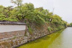 Moat and stone walls of Wakayama castle, Japan Stock Photos