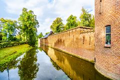 Moat surrounding Castle De Haar, a 14th century Castle completely restored in the late 19th Century. Haarzuilens, Utrecht/the Netherlands - Oct. 1, 2018: Moat stock photography