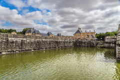Moat surrounding the central building of the estate of Vaux-le-Vicomte, France Stock Photos