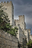 The moat and turrets of the medieval castle Stock Image