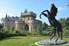 Moated Castle La Clayette With Horse Sculpture Royalty Free Stock Photos