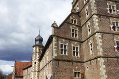 Moated castle Raesfeld Germany - Sun and clouds Stock Photo