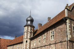 Moated castle Raesfeld Germany - Sun and clouds Royalty Free Stock Photography