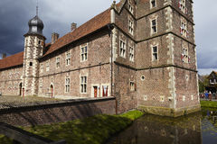 Moated castle Raesfeld Germany - Sun and clouds Stock Images