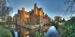 Moated historic house Stock Images