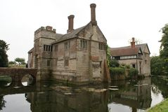 Moated Tudor architecture with a birdge Royalty Free Stock Image