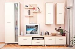 A mobília interior do quarto com arquiva o aparelho de televisão Foto de Stock