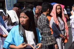 Mob of furious women persecuting Jesus Christ gaher on plaza cheering, ridicule, street drama, community celebrates Good Friday re. San Pablo City, Laguna stock photos