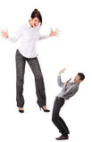 Mobbing concept. Businesswoman shouting on smaller frighten businessman royalty free stock photos