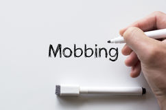 Mobbing written on whiteboard Royalty Free Stock Images