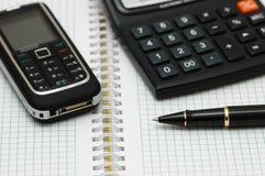 Mobiele telefoon, calculator en p Royalty-vrije Stock Foto