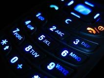Mobiele telefoon in dark Stock Foto
