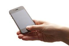 Mobiele telefoon in de handen Royalty-vrije Stock Afbeeldingen