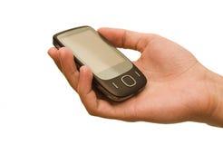 Mobiele telefoon in een hand Stock Foto