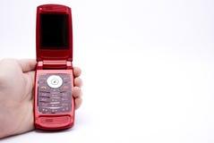 Mobiele telefoon in een hand Stock Afbeelding