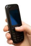 Mobiele telefoon in een hand Royalty-vrije Stock Foto's